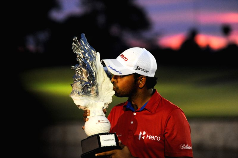 Anirban Lahiri of India kisses the trophy after winning the CIMB Niaga Indonesian Masters at Royale Jakarta Golf Club in Jakarta, Indonesia, April 27, 2014. ...