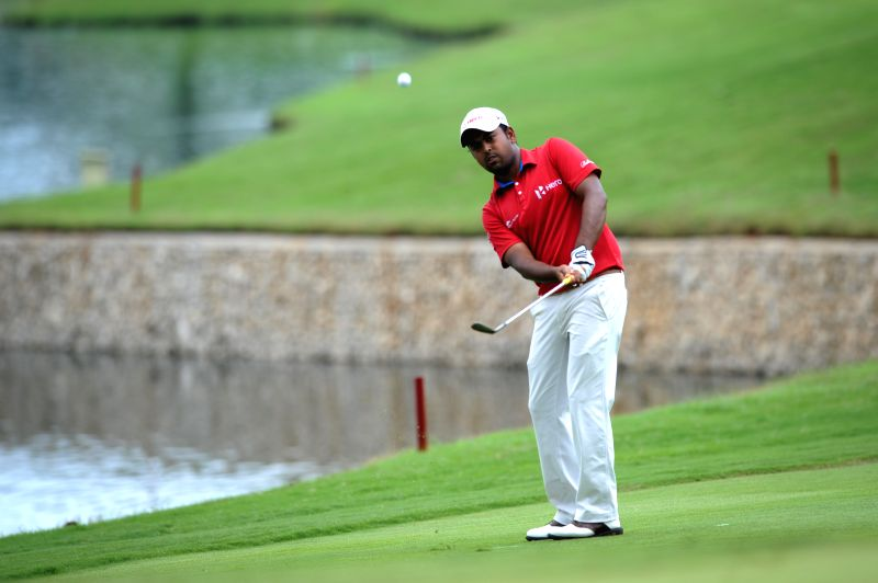 Anirban Lahiri of India hits the ball in the hole 9 during the final day of CIMB Niaga Indonesian Masters at Royale Jakarta Golf Club, Jakarta, Indonesia, April ...