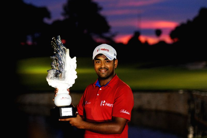 Anirban Lahiri of India poses with the trophy after winning the CIMB Niaga Indonesian Masters at Royale Jakarta Golf Club in Jakarta, Indonesia, April 27, 2014. ...