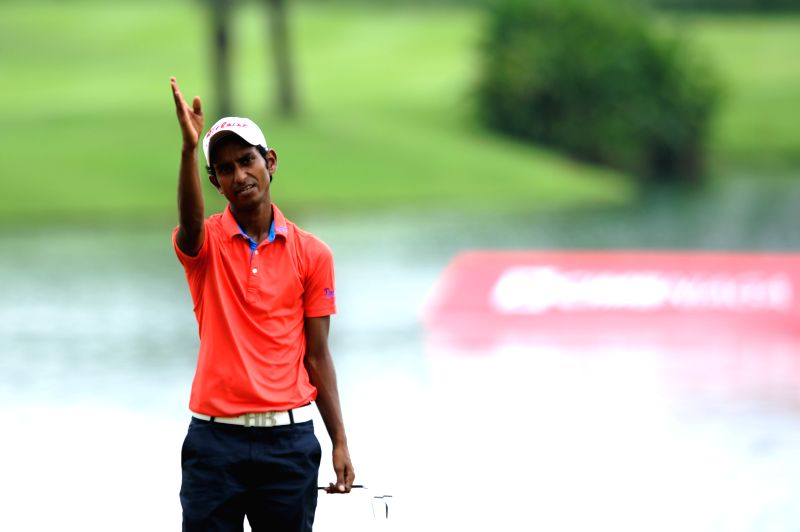 Rashid Khan of India reacts after failing to hit the ball in the hole 9 during the final day of CIMB Niaga Indonesian Masters at Royale Jakarta Golf Club, Jakarta, - Rashid Khan