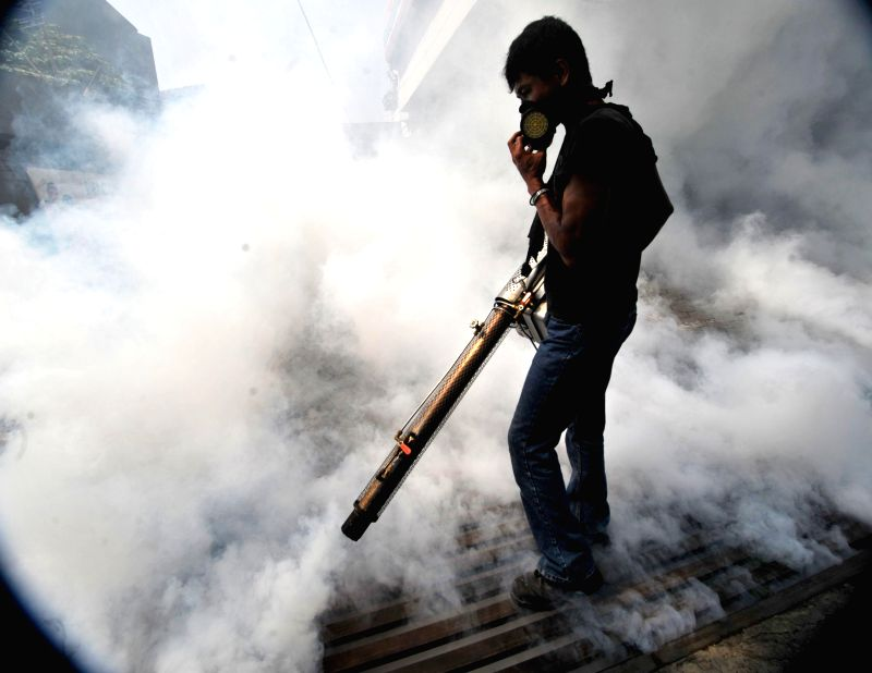 JAKARTA, April 3, 2014 (Xinhua) -- An official makes fog at Bintaro residential to prevent the spreading of the Dengue Fever and Chikungunya fever by mosquitoes which appear in outbreak during the transition from the rainy to dry season, in Jakarta.
