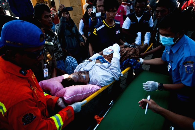 A victim is carried to an ambulance at Marina Port during evacuation of the passengers of KM PAUS SATU ship which burnt on the sea of Thousand Islands in Jakarta, ..