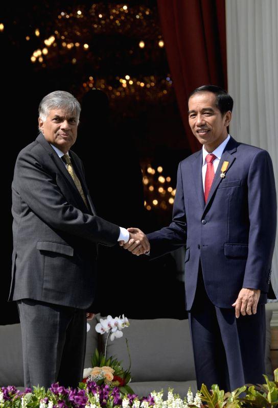 JAKARTA, Aug. 3, 2016 - Indonesian President Joko Widodo (R) shakes hands with visiting Sri Lankan Prime Minister Ranil Wickremesinghe at the backyard of the Presidential Palace in Jakarta, ... - Ranil Wickremesingh