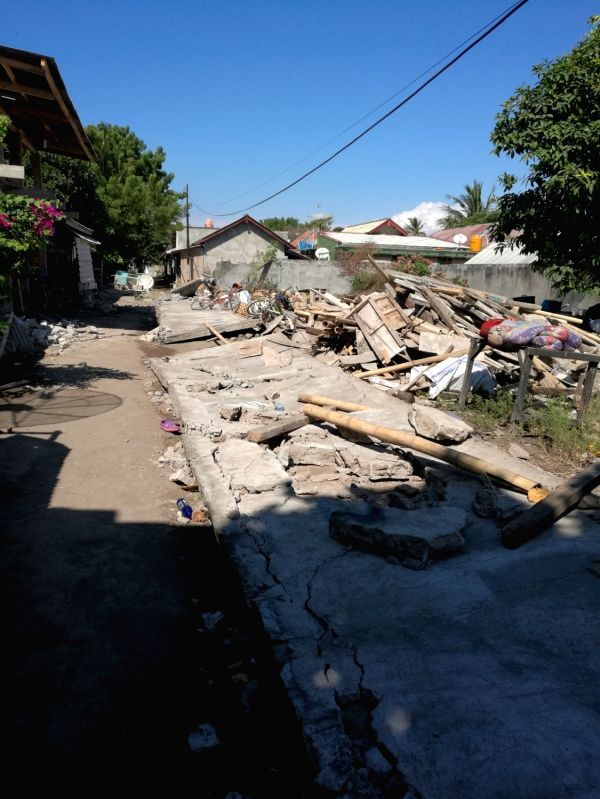 JAKARTA, Aug. 6, 2018 - Photo taken on Aug. 6, 2018 shows damaged houses on Gili Trawangan near Lombok Island in central Indonesia. The death toll rose to 91 and the number of injured people was up ...