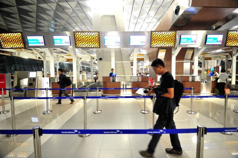 JAKARTA, Aug. 9, 2016 - A man walks in front of check-in counters inside the new Terminal 3 Ultimate at the Soekarno-Hatta International Airport, Banten province, Indonesia, Aug. 9, 2016. The new ...