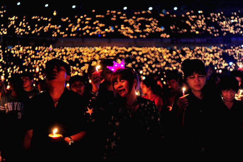 Indonesian Christians hold candles during a Christmas mass pray at Gelora Bung Karno Stadium in Jakarta, Indonesia, Dec. 13, 2014.