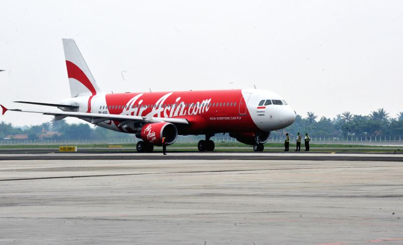Picture taken on April 25, 2013 shows a plane of AirAsia at Soekarno-Hatta airport in Jakarta, Indonesia. AirAsia said Sunday in a statement that it confirmed ...