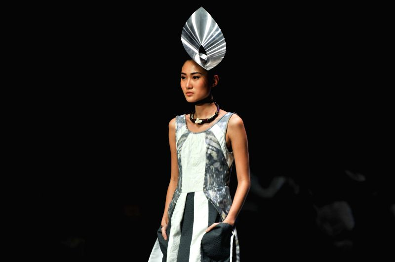 A model presents a creation by Indonesian designer Ernesto Abram during Indonesian Fashion Week 2015 at Convention Center in Jakarta, Indonesia, Feb. 26, 2015. ...