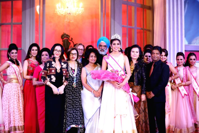 Grace Walia, center, crowned Miss India Indonesia by Gurjit Singh, Ambassador of India to Indonesia at the beauty pageant in Jakarta on Jan 30, 2015. Also present were First Runner – UP, .. - Gurjit Singh, Gurmichele Kaur, Graceful Manraj Kaur, Photogenic Tarana Kapoor and Congeniality Shareen Kaur