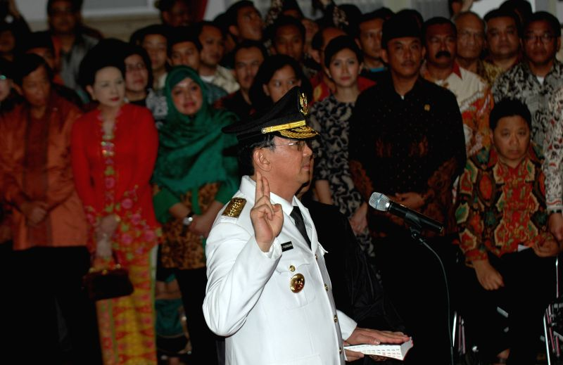 "Jakarta (Indonesia): New Jakarta governor Basuki Tjahaja Purnama better known by his nickname ""Ahok"" swears during the inauguration ceremony at President palace in Jakarta, Indonesia, Nov. ."