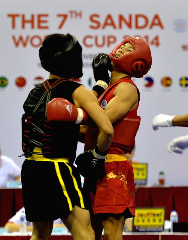 Jakarta (Indonesia): Zhu Yangtao (R) of China and Van Bau To of Vietnam competes during the Men's Sanda 56kg of the 7th Sanda World Cup in Jakarta, Indonesia, Nov. 20, 2014. Zhu Yangtao won 2-0. ...