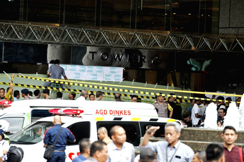 JAKARTA, Jan. 15, 2018 - Police stand guard outside the stock exchange building in Jakarta, capital of Indonesia, Jan. 15, 2018. Part of the building's first floor collapsed on Monday, injuring ...