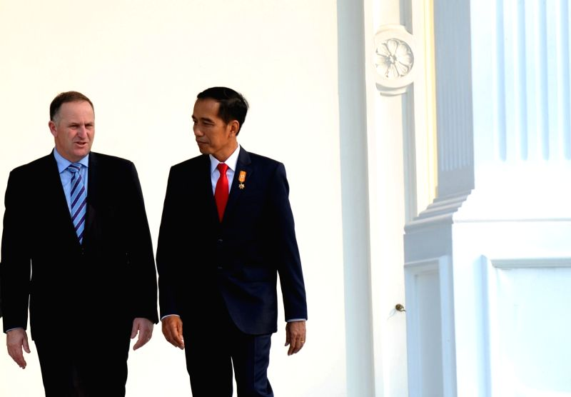 JAKARTA, July 18, 2016 - Indonesian President Joko Widodo (R) talks with New Zealand Prime Minister John Key during the latter's state visit at Presidential Palace in Jakarta, Indonesia, July 18, ... - John Key