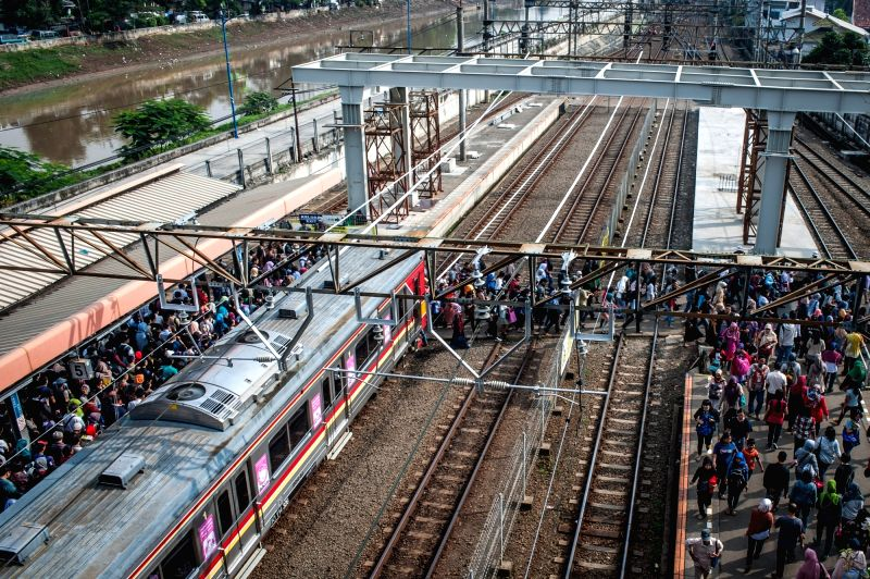 JAKARTA, July 19, 2016 - Commuters crowd at Tanah Abang Station in Jakarta, Indonesia, July 19, 2016. Based on the World Bank report published this June, Indonesia is undergoing a historic ...