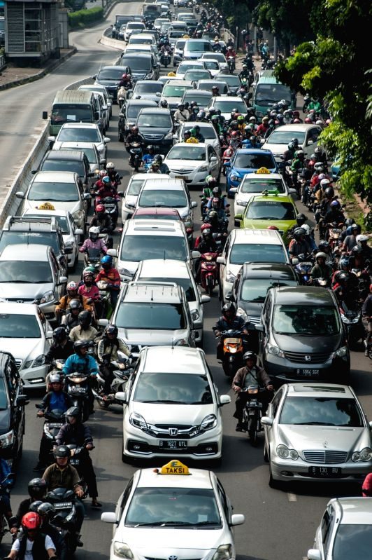 JAKARTA, July 19, 2016 - Photo taken on July 19, 2016, shows vehicles stuck on a road in Jakarta, Indonesia. Based on the World Bank report published this June, Indonesia is undergoing a historic ...
