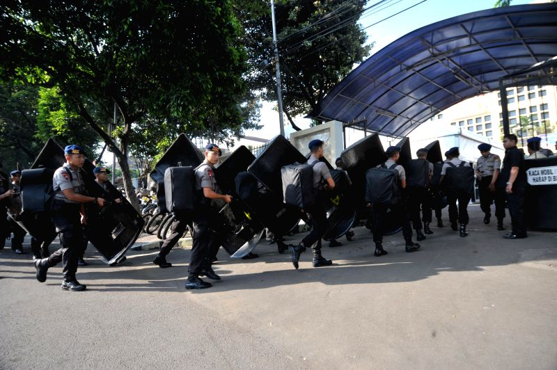 Police officers prepare for security before presidential election result at General Election Commission in Jakarta, Indonesia, July 22, 2014. As the legal schedule .