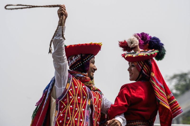JAKARTA, July 26, 2018 - Two Peruvian dancers dance on the street during promotion of their culture exhibition in Jakarta, Indonesia, on July 26, 2018. The Peruvian Embassy in Jakarta held for the ...