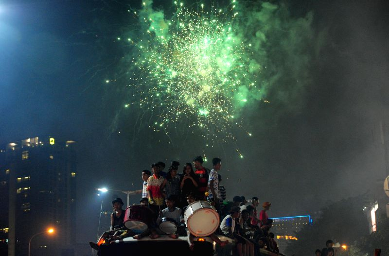 Indonesian Muslims celebrate ahead of Eid al-Fitr in Jakarta, Indonesia, July 27, 2014. Muslims around the world are preparing to celebrate the Eid al-Fitr, which ..