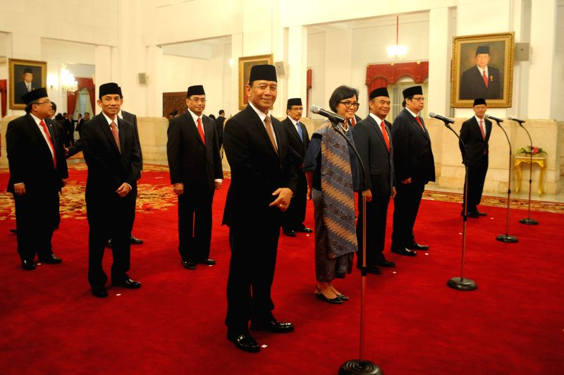 JAKARTA, July 27, 2016 - Indonesia's new ministers pose for photos before the inauguration ceremony of new cabinet at the Presidential Palace in Jakarta, Indonesia, on July 27, 2016. Indonesian ...