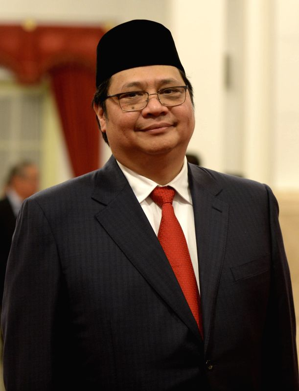 JAKARTA, July 27, 2016 - Indonesia's newly appointed Industry Minister Airlangga Hartarto poses for photos before the inauguration ceremony of new cabinet at the Presidential Palace in Jakarta, ... - Airlangga Hartarto