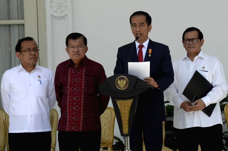 JAKARTA, July 27, 2016 - Indonesian President Joko Widodo (2nd R) and Vice President Jusuf Kalla (2nd L) announce new cabinet at Presidential Palace in Jakarta, Indonesia, July 27, 2016. Indonesian ...