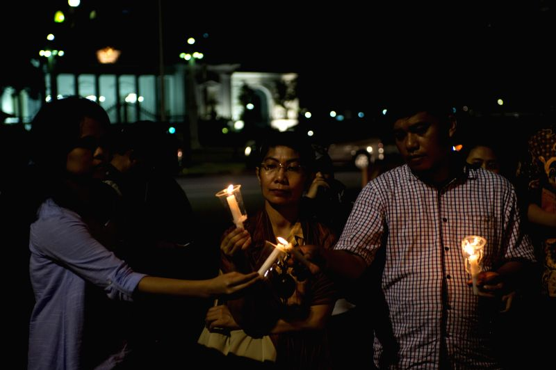 JAKARTA, July 28, 2016 - Activists light candles during a rally to protest against death penalty in front of the Presidential Palace in Jakarta, Indonesia, July 28, 2016. The death penalty against ...