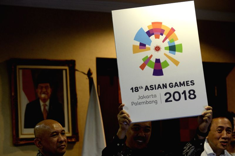 JAKARTA, July 28, 2016 - Indonesian Sport and Youth Minister Imam Nachrowi (C) holds the new logo for the 2018 Asian Games at the presidential palace in Jakarta, Indonesia, July 28, 2016. Indonesian ... - Imam Nachrowi