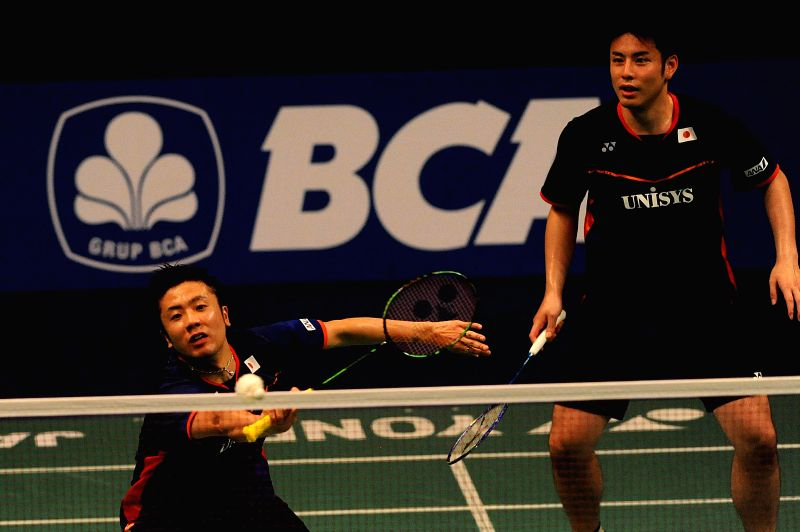 JAKARTA, June 1, 2016 - Hiroyuki Endo (L) and Kenichi Hayakawa of Japan compete during the men's double first round match against Kasper Antonsen and Niclas Nohr of Denmark at the BCA Indonesia Open ...