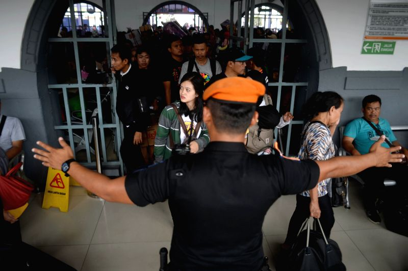 JAKARTA, June 12, 2018 - People queue up for the train to home at Pasar Senen train station in Jakarta, Indonesia, on June 12, 2018. Indonesia's traffic reached its peak each year during the travel ...
