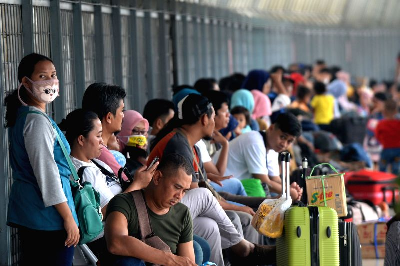 JAKARTA, June 12, 2018 - People wait at Pasar Senen train station in Jakarta, Indonesia, on June 12, 2018. Indonesia's traffic reached its peak each year during the travel period as millions of ...