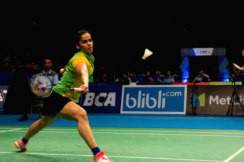 JAKARTA, June 13, 2017 - India's Saina Nehwal returns the shuttlecock to Ratchanok Intanon of Thailand during their women's singles match at Indonesia Open 2017 at Jakarta Convention Center, Jakarta, ...
