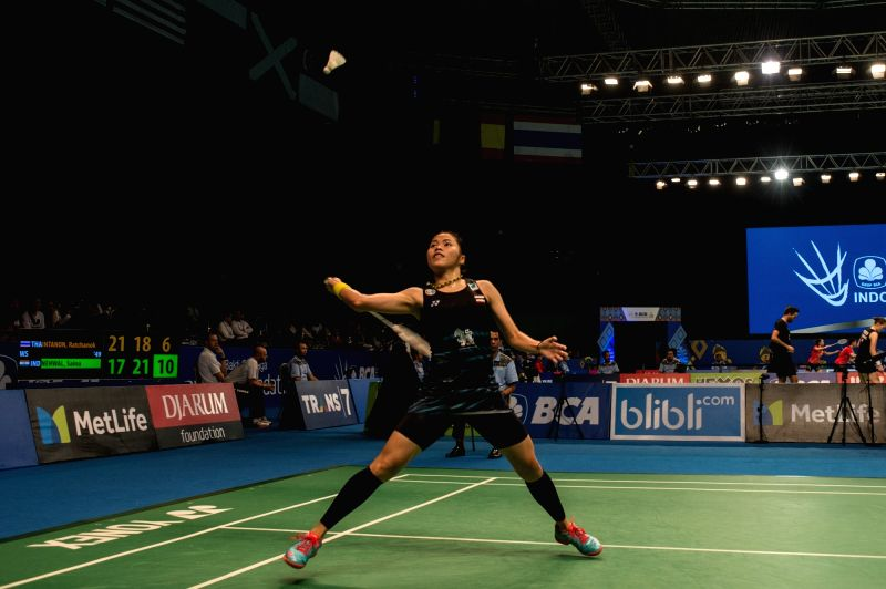 JAKARTA, June 13, 2017 - Ratchanok Intanon of Thailand returns the shuttlecock to India's Saina Nehwal during their women's singles match at Indonesia Open 2017 at Jakarta Convention Center, Jakarta, ...