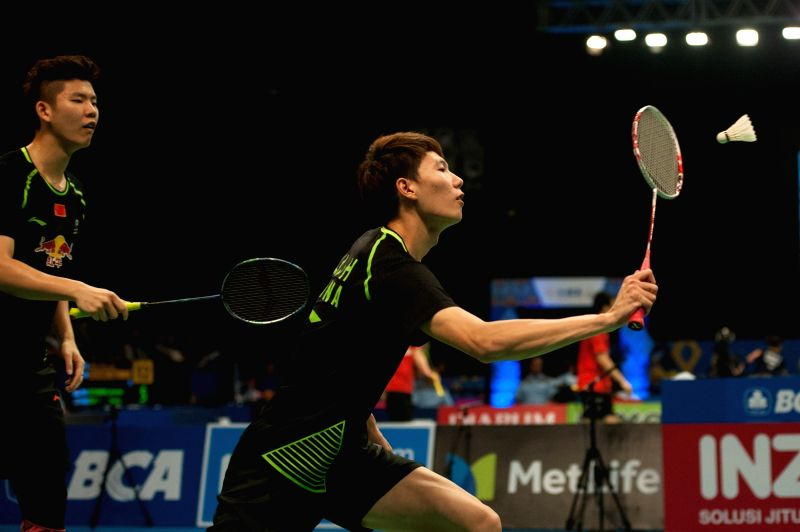 JAKARTA, June 14, 2017 - Liu Yuchen and Li Junhui(R) from China compete against OR Chin Chung and Tang Chun Man from Hong Kong of China during a men's doubles match of Indonesia Open 2017 at Jakarta ...
