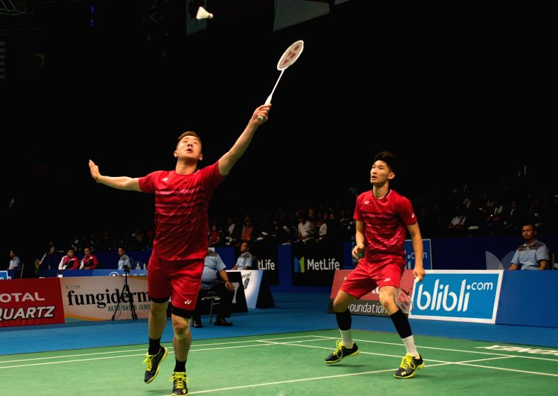 JAKARTA, June 14, 2017 - Tang Chun Man (L) and OR Chin Chung (R) from Hong Kong of China compete against Li Junhui and Liu Yuchen from China during a men's doubles match of Indonesia Open 2017 at ...