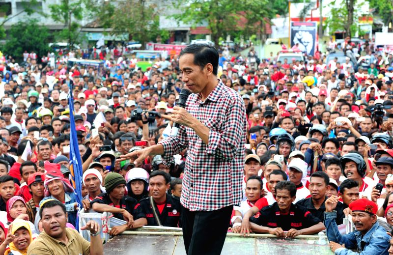 Indonesia's presidential candidate Joko Widodo from the Indonesian Democratic Party of Struggle addresses an election campaign in West Java Province, Indonesia, ...