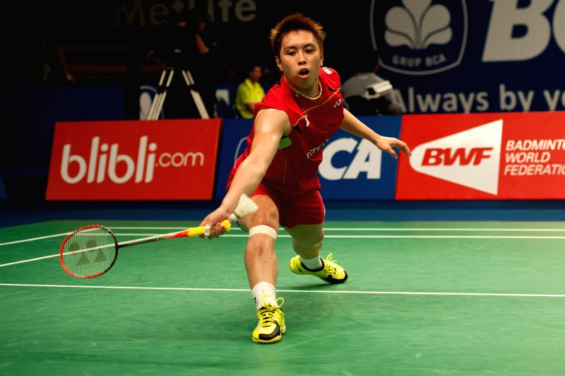 Kenichi Tago of Japan returns the shuttlecock to Parupalli Kashyap of India during round 1 of BCA Indonesia Open 2014 at Istora Senayan Jakarta, Indonesia, June 18, - Parupalli Kashyap