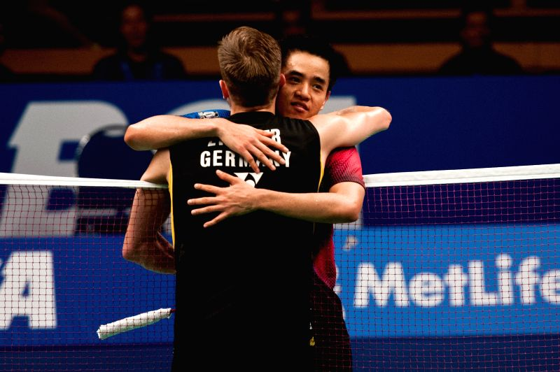 Marc Zwiebler of Germany (front) hugs Simon Santoso of Indonesia during round 1 of BCA Indonesia Open 2014 at Istora Senayan Jakarta, Indonesia, June 18, 2014. ...
