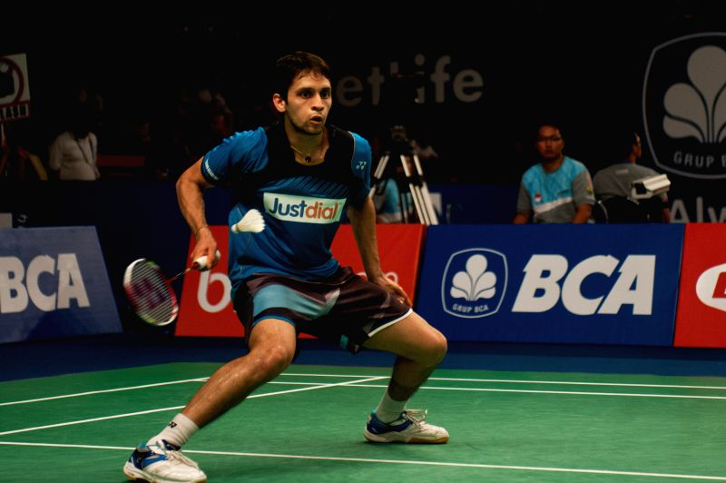 Parupalli Kashyap of India returns the shuttlecock to Kenichi Tago of Japan during round 1 of BCA Indonesia Open 2014 at Istora Senayan Jakarta, Indonesia, June 18, - Parupalli Kashyap