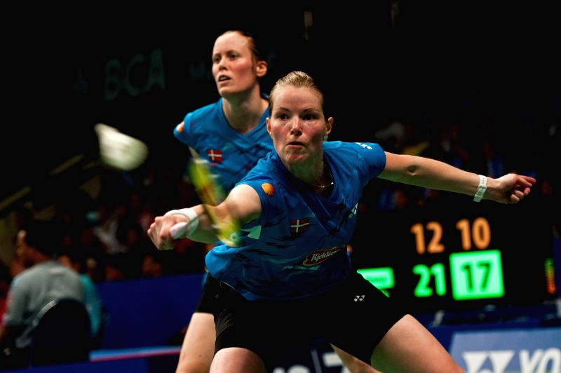 Christinna Pedersen (Front) and Kamilla Rytter Juhl of Denmark compete against Ko A Ra and Yoo Have Won of South Korea during round 2 of BCA Indonesia Open 2014 at .