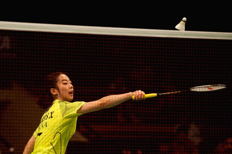 Wang Shixian of China competes against Carolina Marin of Spain during round two of BCA Indonesia Open 2014 at Istora Senayan Jakarta, Indonesia, June 19, 2014. Wang