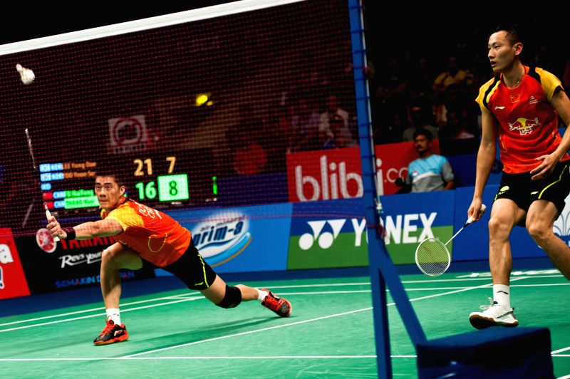 Fu Haifeng (L) and Zhang Nan of China compete during semi-final of BCA Indonesia Open 2014 against Lee Yong Dae and Yoo Yeon Seong of South Korea at Istora Senayan .
