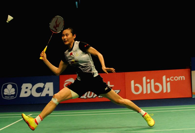 JAKARTA, June 4, 2016 - Wang Yihan of China returns the shuttlecock during the women's single semifinal match against Carolina Marin of Spain at the BCA Indonesia Open 2016 in Jakarta, Indonesia, ...