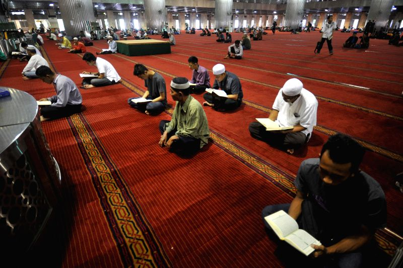 JAKARTA, June 8, 2017 - Indonesian people read the Quran during the Islamic holy month of Ramadan at Istiqlal mosque in Jakarta, capital of Indonesia, June 8. 2017.