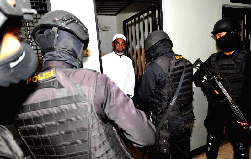 Martin Anderson, a Ghana national who is on death row after being convicted of drug offences, is escorted by armed police officers following a court hearing on ...