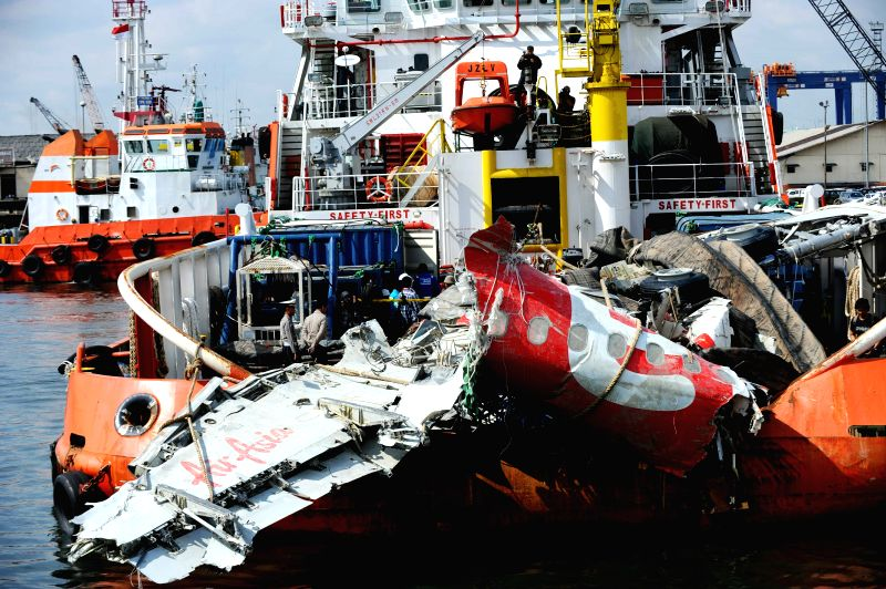 A large part of AirAsia QZ 8501 fuselage is lifted from the rescue ship Crest Onyx at Tanjung Priok harbor in Jakarta, Indonesia, March 2, 2015. Indonesian ...