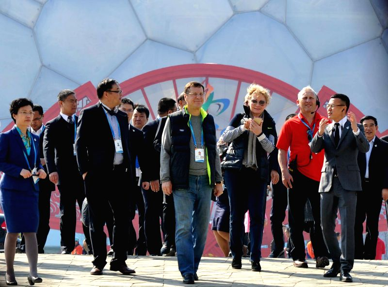 Members of the 2022 Evaluation Commission of the International Olympic Committee (IOC) step into the National Statium in Beijing on March 24, 2015. The ...