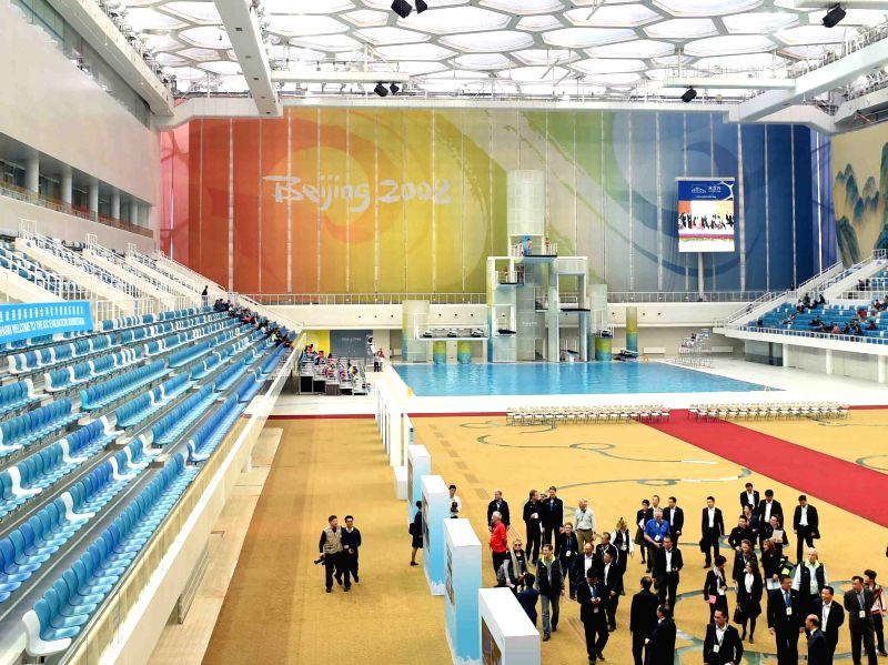 Members of the 2022 Evaluation Commission of the International Olympic Committee (IOC) visit the National Aquatics Center in Beijing on March 24, 2015. The ...