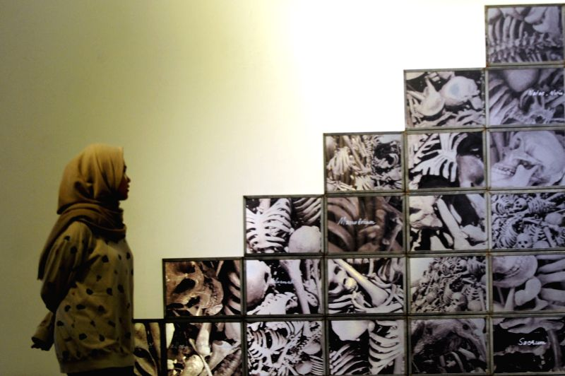 """JAKARTA, May 10, 2016 - A woman looks at art instillation during the Manifesto V: """"Arus"""" contemporary art exhibition at the National Galery in Jakarta, Indonesia, May 10, 2016. About 35 art ..."""