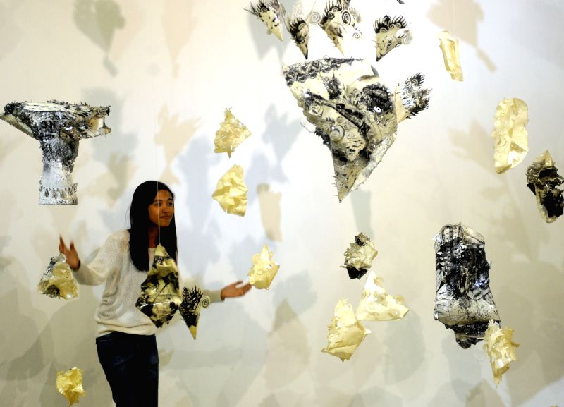 """JAKARTA, May 10, 2016 - A woman poses among art instillation during the Manifesto V: """"Arus"""" contemporary art exhibition at the National Galery in Jakarta, Indonesia, May 10, 2016. About 35 ..."""