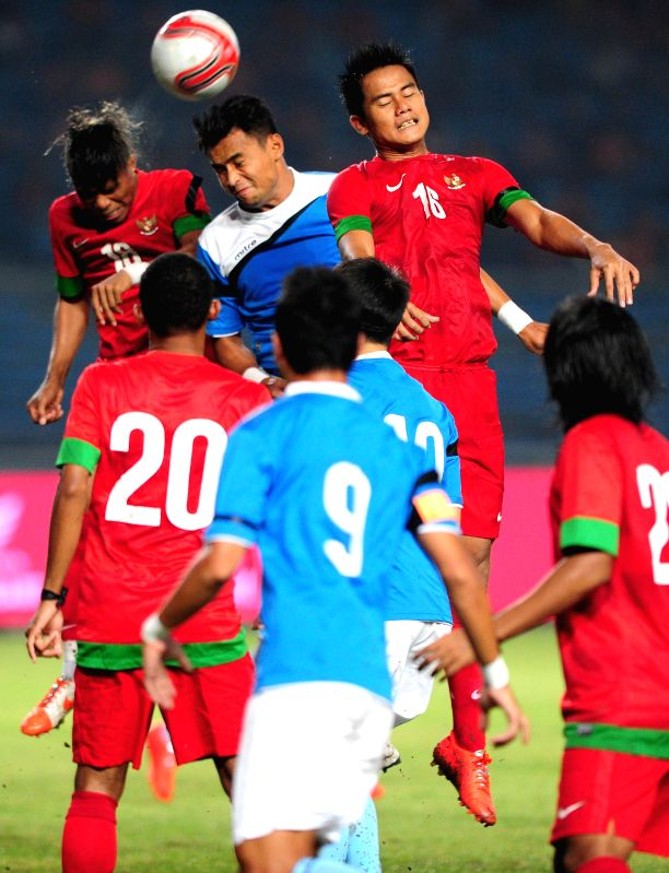 Mohamad Aidil Zafuan bin Abdul Razak (C) of Asean all stars vies with Muhamad Roby (R) and Manahati Lestusen of Indonesia during a charity football match at Gelora ..